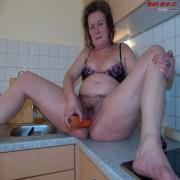 shoving vegetables up her holes