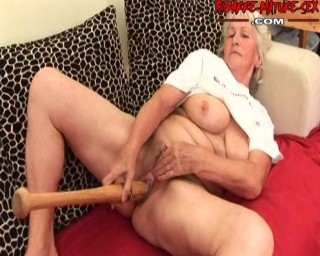 Horny granny getting off on a baseballbat