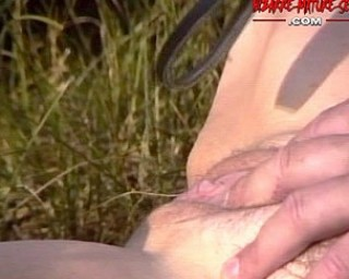 Mature red slave gets it in an open field