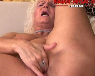 Granny pisses and shoves anything in her holes