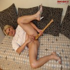 Horny mature slag fucking herself with a baseballbat